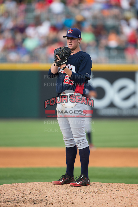 US Collegiate National Team starting pitcher Robert Tyler (22) looks to his catcher for the sign against the Cuban National Team at BB&T BallPark on July 4, 2015 in Charlotte, North Carolina.  The United State Collegiate National Team defeated the Cuban National Team 11-1.  (Brian Westerholt/Four Seam Images)