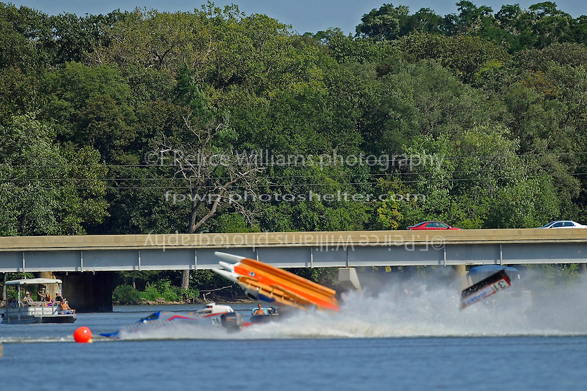Frame 5: #37 Stacy Funk rolls over after contact with #31 Dan Schwartz (red and White boat with it's cowling in the air). Funk rolled completely over while it is speculated that Schwartz was knocked unconscious in the accident and accelerated across the river and crashed onto the golf course. In the later images of this series Schwartz can be seen emerging from behind Funk's boat. (SST-120 class)