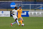 KANSAS CITY, MO - DECEMBER 03:  Elma N'for (9) of Wingate University and Jake Young (2) of the University of Charleston battle for the ball during the Division II Men's Soccer Championship held at Children's Mercy Victory Field at Swope Soccer Village on December 03, 2016 in Kansas City, Missouri. Wingate beat Charleston 2-0 to win the National Championship. (Photo by Jack Dempsey/NCAA Photos via Getty Images)