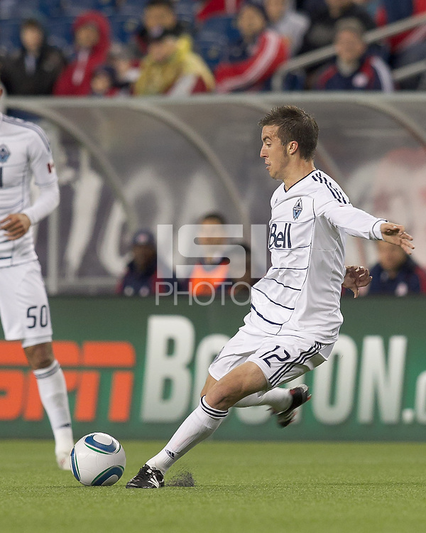 Vancouver Whitecaps FC midfielder Jeb Brovsky (12) passes the ball. In a Major League Soccer (MLS) match, the New England Revolution defeated the Vancouver Whitecaps FC, 1-0, at Gillette Stadium on May14, 2011.