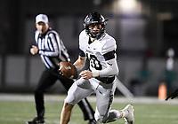 NWA Democrat-Gazette/CHARLIE KAIJO Bentonville Ben Pankau (10) looks for a receiver, Friday, November 8, 2019 during a football game at Bentonville West High School in Centerton.