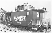 RGS caboose #0400 in a yard with RGS caboose #0404 at left with siding removed.<br /> RGS