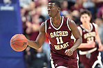 UNCASSVILLE, CT-031818JS04- Sacred Heart's Raheem Solomon (11) pushes the ball up court during their Division I championship game against Notre Dame-Fairfield Sunday at Mohegan Sun Arena. <br /> Jim Shannon Republican-American