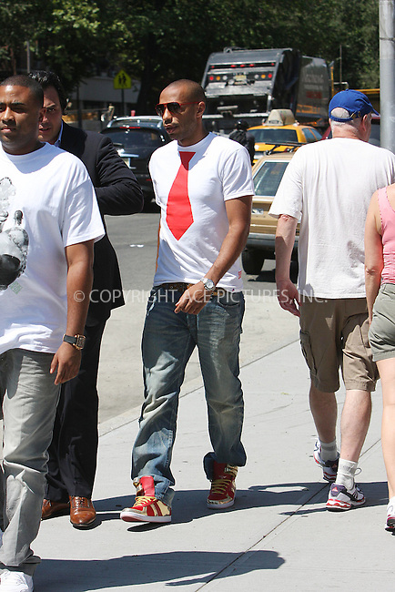 WWW.ACEPIXS.COM ** ** ** ....July 2 2008, New York City....French soccer star Thierry Henry (R) was out with friends on July 2 2008 in Soho, New York City......Please byline: STAN ROSE -- ACEPIXS.COM.. *** ***  ..Ace Pictures, Inc:  ..tel: (646) 769 0430..e-mail: info@acepixs.com..web: http://www.acepixs.com