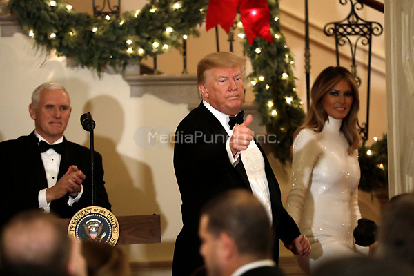 United States President Donald J. Trump with First Lady Melania Trump and US Vice President Mike Pence (L) greet guests at the Congressional Ball at White House in Washington on December 15, 2018. <br /> Credit: Yuri Gripas / Pool via CNP / MediaPunch