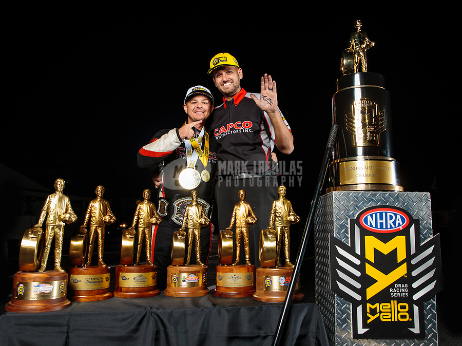Nov 11, 2018; Pomona, CA, USA; NHRA top fuel driver Steve Torrence (left) poses for a portrait with crew member Gary Pritchett as he celebrates after winning the Auto Club Finals at Auto Club Raceway. Torrence swept all six of the countdown to the championship races to clinch the world championship. Mandatory Credit: Mark J. Rebilas-USA TODAY Sports