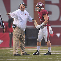 NWA Media/Michael Woods --10/11/2014-- w @NWAMICHAELW...University of Arkansas coach Bret Bielema talks with Brooks Ellis during the 2nd quarter of Saturdays game at Razorback Stadium in Fayetteville.