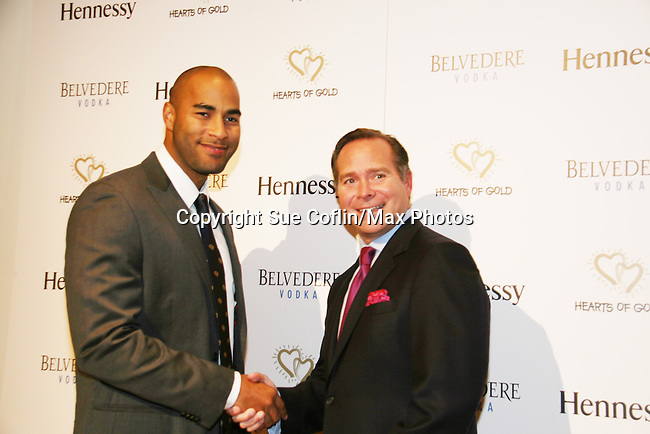 """Designer Robert Valdes-Rodriguez & super model Miguel Perdomo (designed tie for Hearts of Gold) at the The Hearts of Gold 13th Annual Gala """"It's a Love Thing"""" - a benefit gala for Hearts of Gold on November 12, 2009 at the Metropolitan Pavilion, NYC, NY. (Photo by Sue Coflin/Max Photos)"""