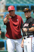 University of Louisville Cardinals manager Dan McDonnell (3) during pregame with Temple University Owls manager Ryan Wheeler at Campbell's Field on May 10, 2014 in Camden, New Jersey. Temple defeated Louisville 4-2.  (Tomasso DeRosa/ Four Seam Images)
