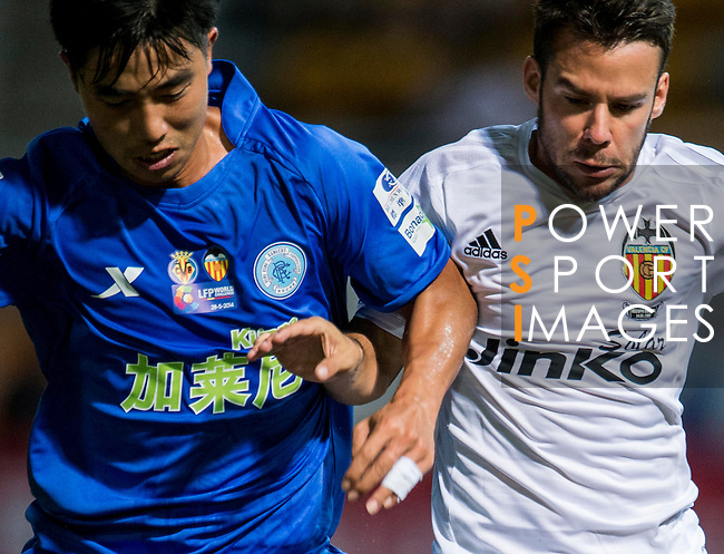 (R) Juan Bernat of Valencia CF competes for the ball with (L) during LFP World Challenge 2014 between Valencia CF vs BC Rangers FC on May 28, 2014 at the Mongkok Stadium in Hong Kong, China. Photo by Victor Fraile / Power Sport Images