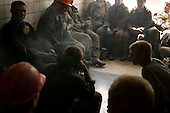 Kirovske, Ukraine.July 30, 2005..Miners come up from their shift and take a  smoke before showering. ..The Komsomolets Donbassa coal mine produces 10,000 tons of energetically coal a day. It exports to Bulgaria, Check, Slovakia, but the most it's coal is sold in the Ukraine. It has 5,000 workers and 3,500 coal-miners. Average monthly salary of a coal-miner is $800.