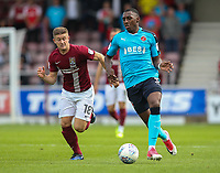 Northampton Town's Aaron Phillips competing with Fleetwood Town's Amari'i Bell <br /> <br /> Photographer Andrew Kearns/CameraSport<br /> <br /> The EFL Sky Bet League One - Northampton Town v Fleetwood Town - Saturday August 12th 2017 - Sixfields Stadium - Northampton<br /> <br /> World Copyright &copy; 2017 CameraSport. All rights reserved. 43 Linden Ave. Countesthorpe. Leicester. England. LE8 5PG - Tel: +44 (0) 116 277 4147 - admin@camerasport.com - www.camerasport.com