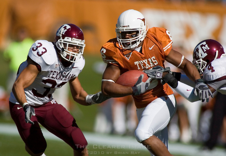24 November 2006: Texas receiver Quan Cosby (#6) tries to dodge Aggie defenders Melvin Bullitt (#33) and Danny Gorrer (#4) during the Longhorns game against the Texas A&M University Aggies at the Darrell K Royal Memorial Field in Austin, TX.