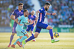 Dimitrios Siovas of CD Leganes (R) fights for the ball with Francisco Alcacer Garcia, Paco Alcacer, of FC Barcelona (L2) during the La Liga 2017-18 match between CD Leganes vs FC Barcelona at Estadio Municipal Butarque on November 18 2017 in Leganes, Spain. Photo by Diego Gonzalez / Power Sport Images
