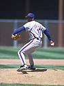 New York Mets Dwight Gooden (16)  in action during a game from the 1987 season with the New York Mets at Shea Stadium in Flushing Meadows, New York. Dwight Gooden played for 16 years all with 5 different teams.