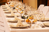 Dining table set for guests at the winery with many wine tasting glasses and a view of the winery vat room Bodega Del Fin Del Mundo - The End of the World - Neuquen, Patagonia, Argentina, South America