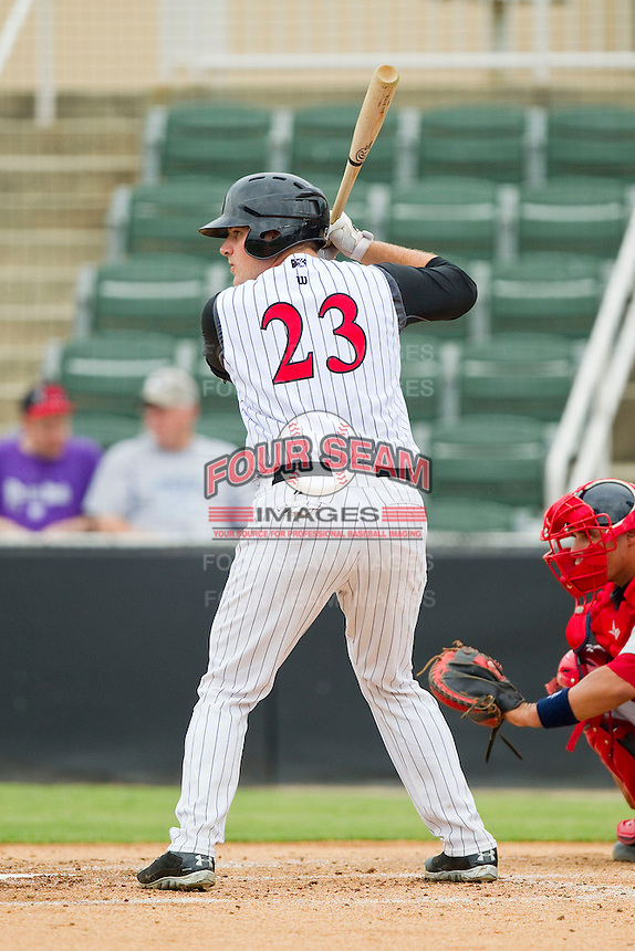 Jeremy Dowdy (23) of the Kannapolis Intimidators at bat against the Greenville Drive at CMC-Northeast Stadium on June 30, 2013 in Kannapolis, North Carolina.  The Drive defeated the Intimidators 3-0.   (Brian Westerholt/Four Seam Images)
