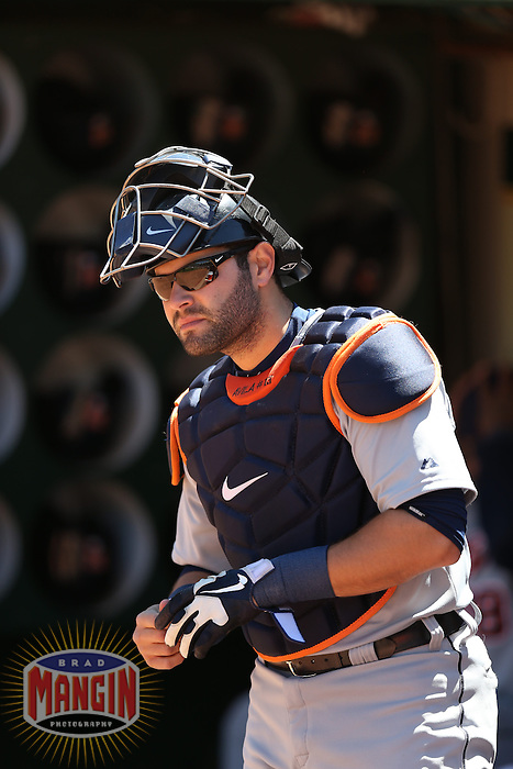 OAKLAND, CA - APRIL 14:  Alex Avila #13 of the Detroit Tigers gets ready in the dugout before the game against the Oakland Athletics on Sunday, April 14, 2013 at The O.co Coliseum in Oakland, California. Photo by Brad Mangin