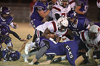 NWA Democrat-Gazette/ANDY SHUPE<br /> Fordyce running back Quartey Shelton (7) carries the ball Friday, Nov. 10, 2017, as he is hit by Elkins Logan Shoffit (60) during the first half of play at John Bunch Jr. Memorial Field in Elkins. Visit nwadg.com/photos to see more photographs from the game.