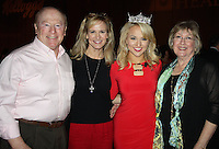 NWA Democrat-Gazette/CARIN SCHOPPMEYER Miss America Savvy Shields (second from right) is joined by family members Don Shields, Karen Shields and Patty Jensen at the Go Red Luncheon on Feb. 23 at the John Q. Hammons Center in Rogers. Savvy was the keynote speaker for the American Heart Association benefit.