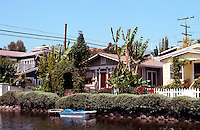 Venice CA: Old cottages along Howland Canal, 2001. (With a 30' height limit, these are certainly doomed.)