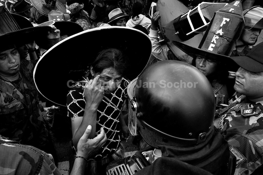 An Indian shouts at the police during the Inti Raymi (San Juan) festivities in Cotacachi, Ecuador, 24 June 2010. 'La toma de la Plaza' (Taking of the square) is an ancient ritual kept by Andean indigenous communities. From the early morning of the feast day, various groups of San Juan dancers from remote mountain villages dance in a slow trot towards the main square of Cotacachi. Reaching the plaza, Indians start to dance around. They pound in synchronized dance rhythm, shout loudly, whistle and wave whips, showing the strength and aggression. Dancers from either the upper communities (El Topo) or the lower communities (La Calera), joined in respective coalitions, seek to conquer and dominate the square and do not let their rivals enter. If not moderated by the police in time, the high tension between groups always ends up in violent clashes.