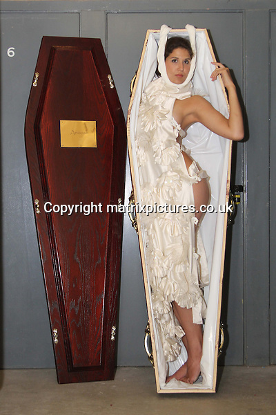 NON EXCLUSIVE PICTURE: GRAHAM READING / MATRIXPICTURES.CO.UK<br /> PLEASE CREDIT ALL USES<br /> <br /> WORLD RIGHTS<br /> <br /> Model Karine Tonson La Tour is pictured modelling some of designer Anoosh Naghibi's pieces at his Hendon studio, in the lead up to his &quot;Live Fashion Funeral&quot; show for London Fashion Week.<br />  <br /> SEPTEMBER 13th 2013<br /> <br /> REF: GRG 136113