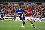 Nottingham Forest defender Chris Gunter winning the ball from Ipswich substitute Connor Wickham during the second half at the City Ground, Nottingham as Forest take on visitors Ipswich Town in an Npower Championship match. Forest won the match by two goals to nil in front of 22,935 spectators, with McGoldrick scoring the first goal.