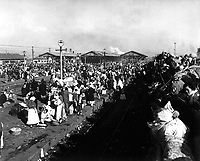 Refugees crowd railway depot at Inchon, Korea, in hopes they may be next to get aboard for trip further south and safety from communist hordes.  January 3, 1951.  C.K. Rose. (Navy)<br /> NARA FILE #:  080-G-425418<br /> WAR &amp; CONFLICT BOOK #:  1476