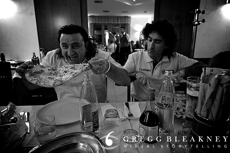 After the team has finished dinner, mechanics Lucca and Licio arrive at dinner hungry and ready to hammer down some made-to-order pizza.