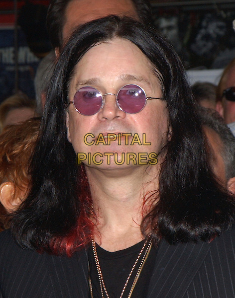 OZZY OSBOURNE .attends the ceremony to posthumously induct Randy Rhoads into the Hollywood Rockwalk in Hollywood, California .18 March 2004.*UK Sales Only*.portrait, headshot, sunglasses, shades.www.capitalpictures.com.sales@capitalpictures.com.©Capital Pictures.