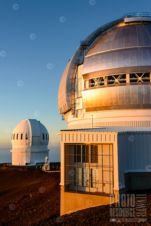 Two observatories in the light of a setting sun, Mauna Kea, Island of Hawai'i.