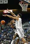 Nevada's AJ West (3) fouls Utah State's Chris Smith (34) during an NCAA college basketball game in Reno, Nev., on Tuesday, Jan. 20, 2015. (AP Photo/Cathleen Allison)