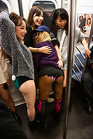NEW YORK - NEW YORK. JANUARY 12: Participants of the No Pants Subway Ride take a ride on the NYC subway system on January 12, 2020 in New York. The annual event, in which participants board a subway car in January while not wearing any pants while behaving as though they do not know each other, began as a joke by the public prank group Improv Everywhere in New York City and has since spread around the world, with enthusiasts in around 60 cities and 29 countries across the globe, according to the organization's site.  (Photo by Pablo Molsalve/VIEWpress)