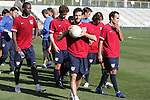 Ben Olsen (with ball), and teammates (in red, from left) Eddie Johnson, Pat Noonan, Frankie Hejduk, and Landon Donovan leave the field at the end of training on Monday, April 10th, 2006 at SAS Stadium in Cary, North Carolina. The United States Men's National Team practiced the day before playing an international friendly against Jamaica.