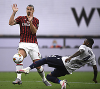 Zlatan Ibrahimovic of AC Milan and Stefano Denswil of Bologna FC compete for the ball during the Serie A football match between AC Milan and Bologna FC at stadio Giuseppe Meazza in Milano ( Italy ), July 18th, 2020. Play resumes behind closed doors following the outbreak of the coronavirus disease. <br /> Photo Image Sport / Insidefoto