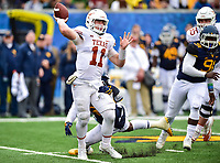 Morgantown, WV - NOV 18, 2017: Texas Longhorns quarterback Sam Ehlinger (11) throws the ball under pressure from West Virginia defense during game between West Virginia and Texas at Mountaineer Field at Milan Puskar Stadium Morgantown, West Virginia. (Photo by Phil Peters/Media Images International)