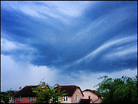 BNPS.co.uk (01202 558833)<br /> Pic: StuartWillis/BNPS<br /> <br /> ***Must use full byline***<br /> <br /> Storm clouds gather...<br /> <br /> A huge bolt of lightning forks sideways over rooftops as thunderstorms brought on by the recent hot spell swept across Britain.<br /> <br /> The dramatic weather conditions formed as warm air clashed with a cold front moving in over the country.<br /> <br /> The storms marked the end of a mini heatwave which culminated in the hottest day of the year so far yesterday (Mon) with temperatures hitting a sultry 26 degrees in the south east.<br /> <br /> The apocalyptic scene was caught on camera by Stuart Willis, who snapped the photos on his iPhone from his bedroom window in Taunton, Devon.
