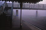 AYBR8B Foggy railway station early morning with bridge crosing to other platform