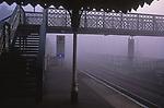 AYBR8B Foggy railway station early morning with bridge crosing to other platform