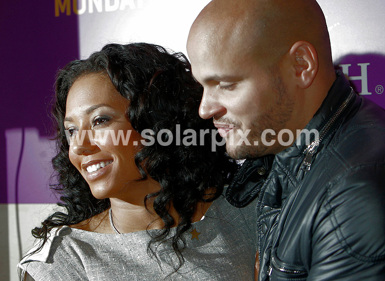 **ALL ROUND PICTURES FROM SOLARPIX.COM**.**NO UK NEWSPAPER PUBLICATION **UK MAGAZINE PUBLICATION ONLY** AND NO PUBLICATION IN FRANCE, SCANDINAVIA, AUSTRALIA AND GERMANY** .Spice Girl Mel B (Melanie Brown) with her husband Stephen Belafonte, took part in a Christmas sing-a-long for the Make A Wish charity at Selfridges in London this evening. 17th December 2007 ..JOB REF: 5515 SFE       DATE:  17_12_2007.**MUST CREDIT SOLARPIX.COM OR DOUBLE FEE WILL BE CHARGED* *UNDER NO CIRCUMSTANCES IS THIS IMAGE TO BE REPRODUCED FOR ANY ONLINE EDITION WITHOUT PRIOR PERMISSION*