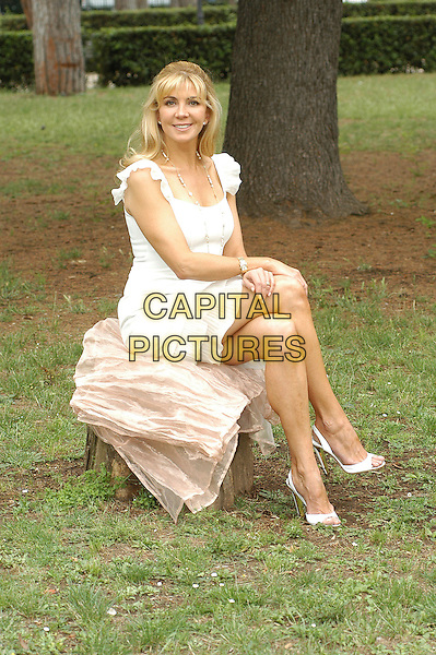"NATASHA RICHARDSON.Photocall for ""Asylum"", Rome, Italy..June 6th, 2007.full length white dress sitting.CAP/CAV.©Luca Cavallari/Capital Pictures"