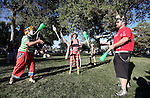 From left, Zippy, LoTops and Spike McGuire juggle at the NV150 Fair at Fuji Park, in Carson City, Nev., on Friday, Aug. 1, 2014.<br /> Photo by Cathleen Allison