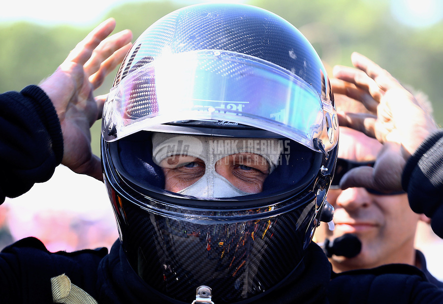 Aug. 17, 2013; Brainerd, MN, USA: NHRA funny car driver Chad Head during qualifying for the Lucas Oil Nationals at Brainerd International Raceway. Mandatory Credit: Mark J. Rebilas-