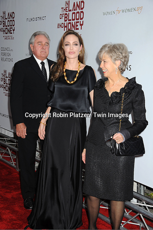 "Angelina Jolie with Bill and Jane Pitt attend The New York Premiere of Angelina Jolie's movie "" In the Land of Blood and Honey"" on December 5, 2011 at The School of Visual Arts Theatre in New York City."