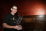 "As The World Turns' Trent Dawson ""Henry Coleman"" holds his award - trophy given as appreciation from his fans at his 6th Annual Martinis With Henry on April 17, 2010 at Latitude, New York City, New York. (Photo by Sue Coflin/Max Photos)"