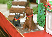 Washington, DC - December 4, 2000 -- Detail of Clinton pets Socks, the cat and Buddy, the dog in front the traditional gingerbread house in the State Dining Room of the White House in Washington, D.C. on December 4, 2004.  Socks and Buddy have been recreated on the gingerbread house each year of the Clinton Administration..Credit: Ron Sachs - CNP