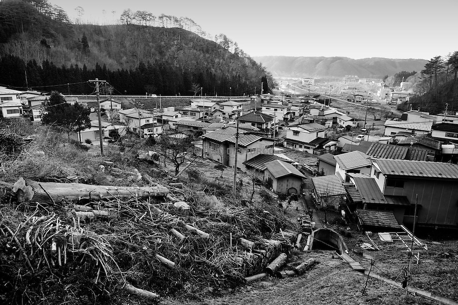New Life in Taro Village, December 2011..In the north east of Japan there is a small city called Taro that was completely destroyed by the tsunami on the 3/11. After the tsunami the whole population of 8000 people moved to the top of the mountain where they settled down.  .Here they had temporary housing, temporary shops, a japanese warm bath and a temporary clinic provided by MSF. Almost one year later they are still living there, they have created their own new little community village and this has became the new reality for them. In this small colony you can find barber shops, restaurants, grocery stores, schools and a playground just like a normal village. The colony is not far from the sea so, as the majority of the population from Taro are fishermen, they don't find it too hard to survive in their new environment. From a temporary shelter this has became the new TARO Village.