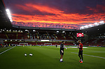Sheffield Utd players warm up under a blood red sky during the League One match at Bramall Lane Stadium, Sheffield. Picture date: September 27th, 2016. Pic Simon Bellis/Sportimage