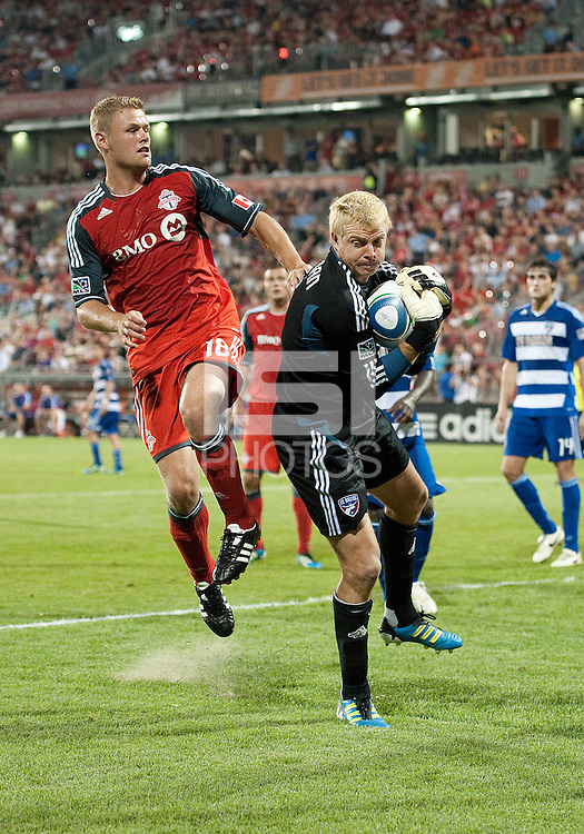 FC Dallas goalkeeper Kevin Hartman #1 and Toronto FC forward Nick Soolsma #18 in action during an MLS game between the FC Dallas and the Toronto FC at BMO Field in Toronto on July 20, 2011..FC Dallas won 1-0.